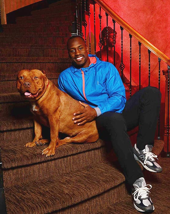 Vernon Leonard Davis tight end for the San Francisco 49ers with his dog during a Sports Illustrated shoot
